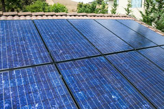 Blue solar panels in Sunlight. The most power generated from the sun at direct angles Stock Photo