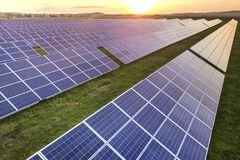 Free Blue Solar Photo Voltaic Panels System Producing Renewable Clean Energy On Rural Landscape And Setting Sun Background Stock Photography - 153629252