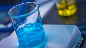 Blue Solution In Glass Beaker royalty free stock photography