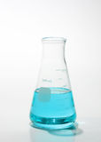 Blue solvent in lab glass container Stock Images