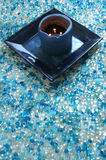 Blue spa candle. Blue candle on blue stones Royalty Free Stock Image