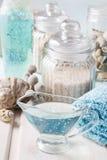 Blue spa set: liquid soap, sea salts and towels Royalty Free Stock Photos