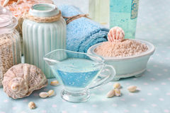 Blue spa set: liquid soap, sea salts and towels Royalty Free Stock Photos