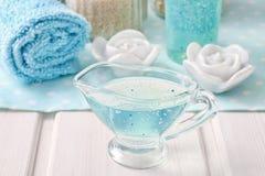 Blue spa set: liquid soap, sea salts and towels Stock Image