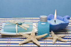 Blue spa and wellness. Spa background in blue with some hygiene items on a bamboo mat Royalty Free Stock Images