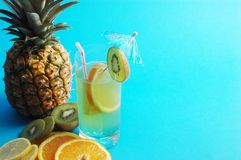 Blue space. And drink, pineapple, and oranges Royalty Free Stock Photography