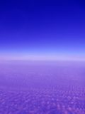 Blue space sky with violet clouds Royalty Free Stock Image