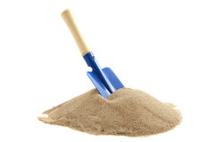 Blue spade. Pile of sand with spade isolated over white stock image