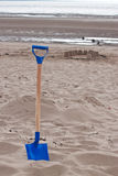 Blue spade with sandcastles Stock Photography