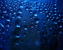 Blue sparkling drops stock photography
