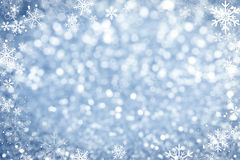 Blue Sparkling Lights Background. With Graphical Snowflake Border Royalty Free Stock Photo