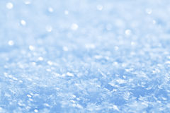 Blue sparkling snow background. Stock Photos