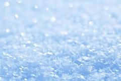 Blue sparkling snow background. Blue sparkling snow background with white little snowflakes Stock Photos