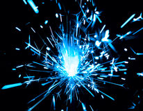 Blue sparks of bengal light Stock Image