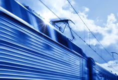 Blue speed train in motion. Blue high speed train with motion blur stock image