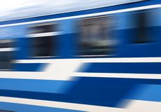 Blue speed train in motion Stock Photo