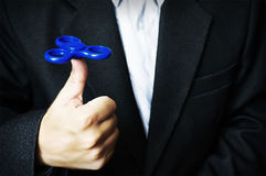Blue spinner in the hand of a man Royalty Free Stock Image