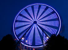Blue Spinning Ferris Wheel Royalty Free Stock Photos