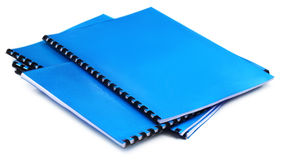 Blue Spiral bound note books. Over white background Royalty Free Stock Photography