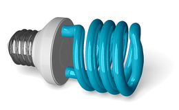 Blue spiral light bulb lying Stock Photos