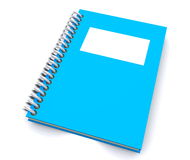 Blue spiral notebook. Blue and white spiral paper notebook with a blank cover on a white background Stock Photos
