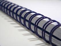 Blue spiral notebook. High key detail of a blue spiral notebook Stock Photo