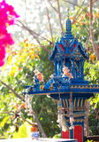 Blue spirit house in thailand with flower vases Royalty Free Stock Images