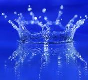 Blue splash. Fresh blue water splash. background stock photos