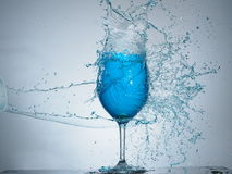 Blue splash colision. Another splashing with glass of wine Stock Images