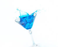 Blue splash in a glass Royalty Free Stock Photo