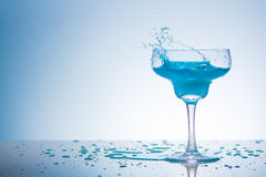 Blue splash. In a transparent glass Royalty Free Stock Photos