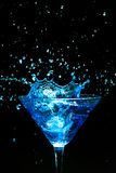 Blue splashing cocktail Royalty Free Stock Image
