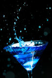 Blue splashing cocktail Royalty Free Stock Photography