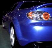 Blue Spoiler. Blue sportscar from the rear stock photos