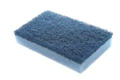 Blue sponge. Blue kitchen sponge - isolated over white background royalty free stock photography