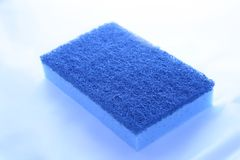 Blue sponge. Blue kitchen sponge - isolated over white background royalty free stock photos