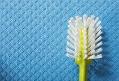 Blue sponge background and brush Stock Photos