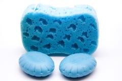 Blue sponge with soap. On white background Stock Image