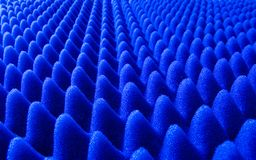Blue sponge Structure. Sheet of blue shipping sponge wrap shaped in multiple cones royalty free stock photo