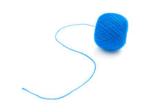 Blue spool of thread on white Stock Photo