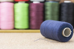 Blue spools of thread on sackcloth Stock Photography