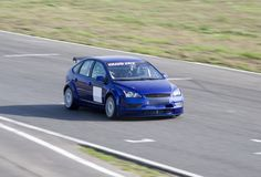 Blue sportcar in a race stock photography