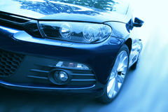 Blue sports car. An image of a blue sports car on the road royalty free stock photos