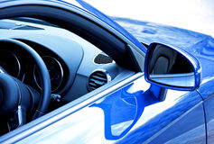 Blue sports car. Mirror and dashboard on blue sports car stock image