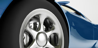 Blue sports car detail. Close-up of the wheel of a metallic blue sports car Stock Photos