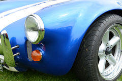 Blue sports car fender. Closeup of the front fender of a racy blue sports car Royalty Free Stock Photo