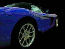 Blue Sports car Side View. Blue convertible sports car isolated on a black background Royalty Free Stock Image