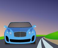 Blue sports car traveling on the road to turn. Royalty Free Stock Image