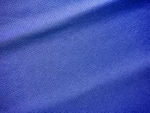 Sports clothing fabric jersey texture. Blue sports clothing fabric jersey texture Stock Photos
