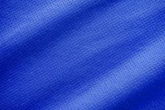 Sports clothing fabric jersey texture. Blue sports clothing fabric jersey texture Stock Photography